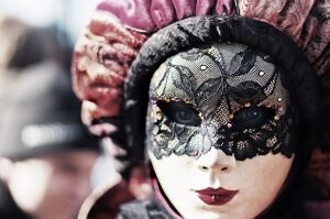a woman wearing a mask for the Venice carnival
