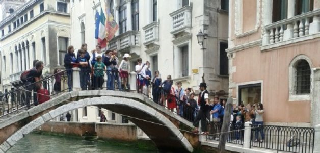 Venice Clown does Balancing Act over Canal